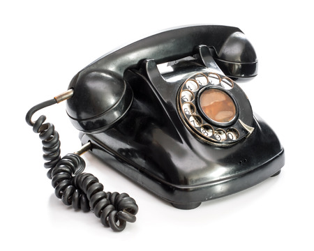 Old telephone on white background. Stock Photo