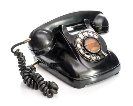 Old telephone on white background. Foto de archivo