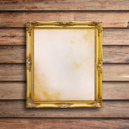 mirror image: Old picture frame on vintage wood wall. Stock Photo