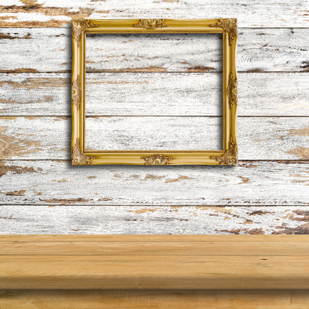 Old picture frame on vintage wood wall. photo