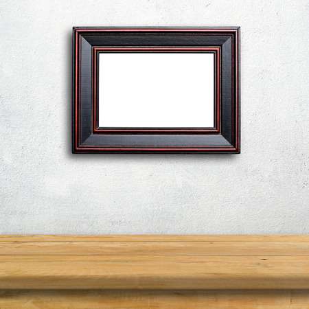 mirror on wall: Picture frame on white wall.