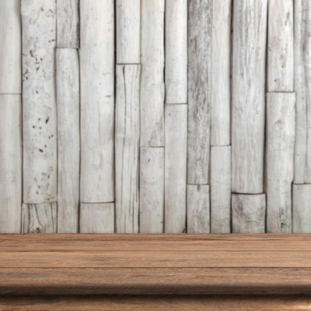 Vintage wood table in wood wall room. photo