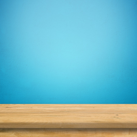 Vintage wood table in blue wall room.