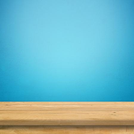 Vintage wood table in blue wall room.