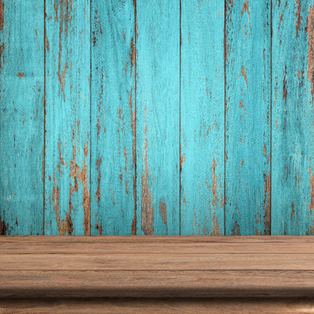 Vintage wood table in wood wall room. Imagens