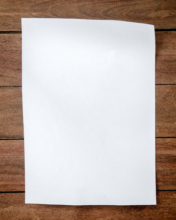 a4: White paper A4 size on wood.