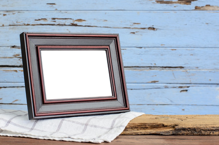 Picture frame put on wood table in wood wall room. photo