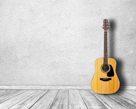 grunge room: Guitar in white room. Stock Photo
