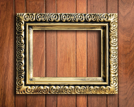 old picture: Old picture frame on vintage wood wall. Stock Photo