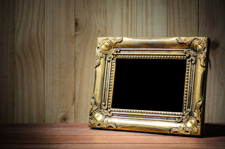 photo backdrop: Old picture frame put on wood background. Stock Photo