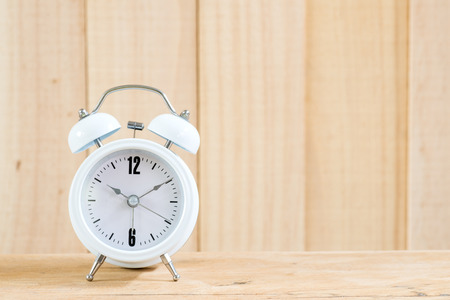 ten empty: Alarm clock on wood background.
