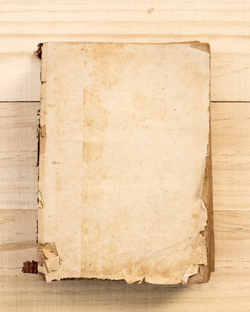 tattered: Old book on old wood. Stock Photo