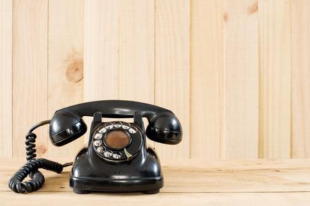 Old telephone on wood background. photo