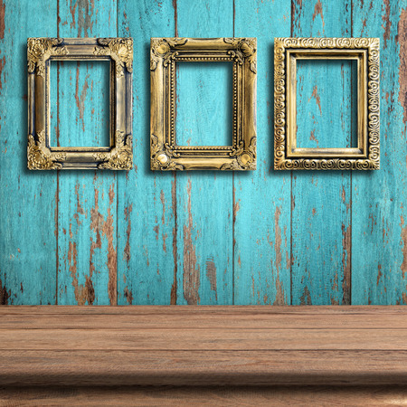Old picture frame on vintage wood wall. Imagens