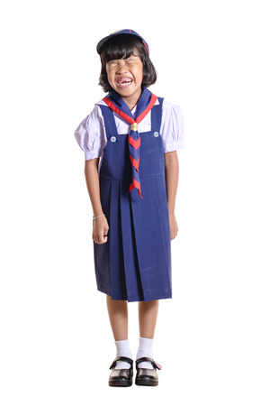 schooler: Young asian student on white background. Stock Photo