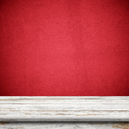 room wall: Vintage wood table in red wall room. Stock Photo