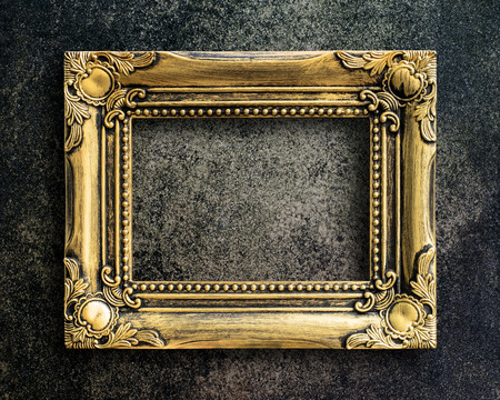 photo backdrop: Old picture frame on grunge wall. Stock Photo