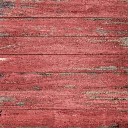 fondo rojo: Fondo de la vendimia de madera con la pintura descascarada., Color rojo. Foto de archivo