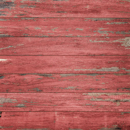 Vintage wood background with peeling paint., Red color.
