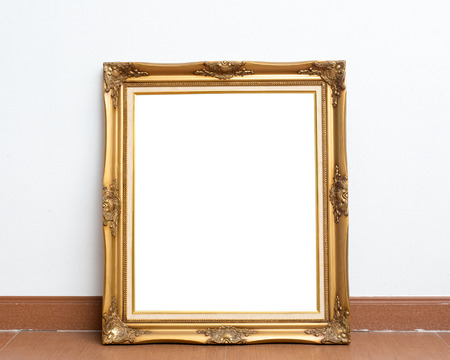 antique table: Picture frame on white wall room. Stock Photo