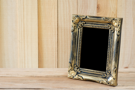 old frame: Old picture frame put on wood background. Stock Photo