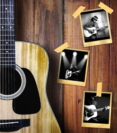 indoor photo: Guitar and guitarist photo photo frame on wood background.