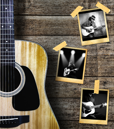grunge music background: Guitar and guitarist photo photo frame on wood background.