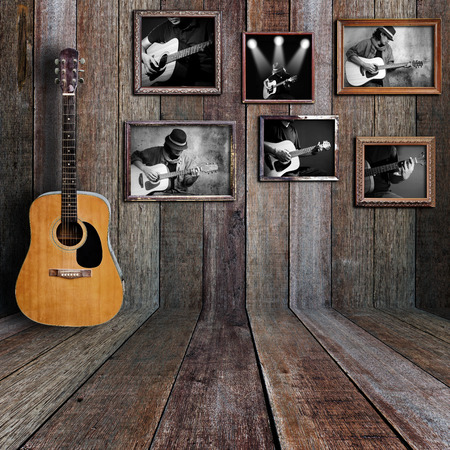 frame wall: Guitar player photo in vintage wood room.