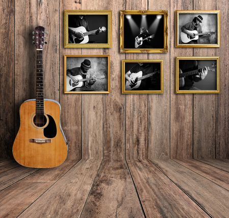 Guitar player photo in vintage wood room. 版權商用圖片 - 44639417