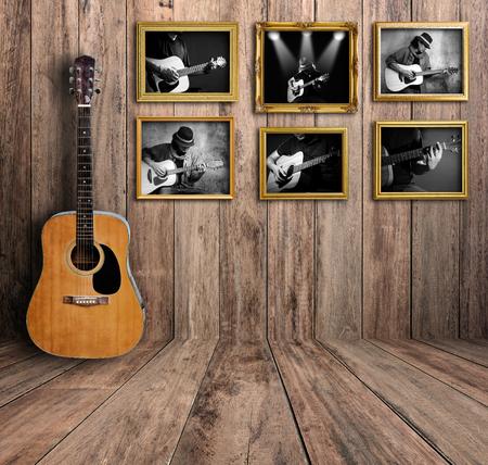 Guitar player photo in vintage wood room.
