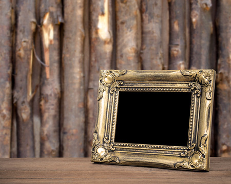 marcos decorativos: Old picture frame put on wood background. Sepia tone.