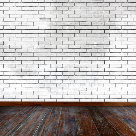 white wood floor: Empty room. White brick wall and wood floor.