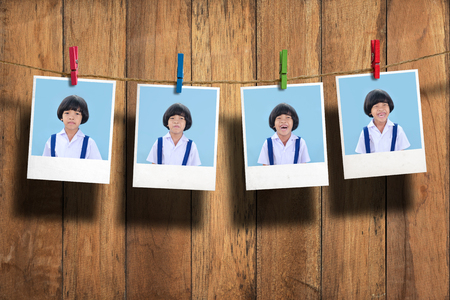 too many: Young student photo hanging on clothesline on wood background.,Too many emotion.