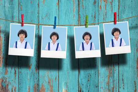 students group: Young student photo hanging on clothesline on wood background.,Too many emotion.