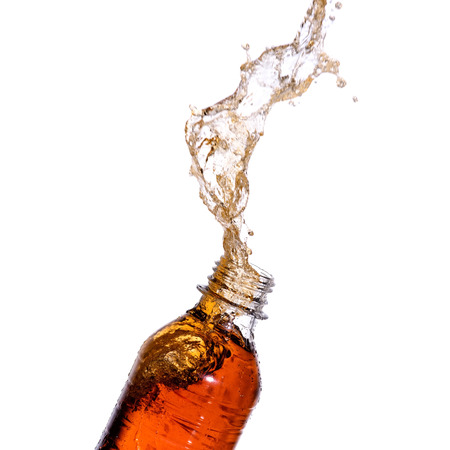 sodas: Soda splash out of bottle on white background.