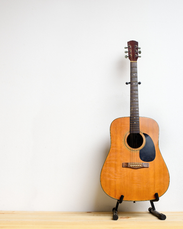 vintage background: Guitar in white room. Stock Photo