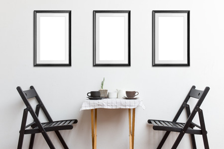 Three mock-up poster frame in coffee corner interior background.