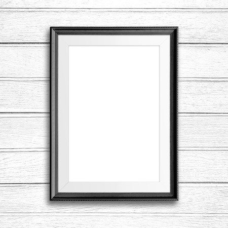 Picture frame on white wood wall.
