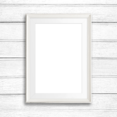 white wood: Picture frame on white wood wall.
