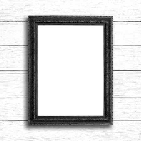 Black picture frame on white wood wall.