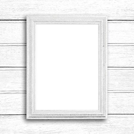 Weiß Bilderrahmen auf weißem Holz-Mauer.