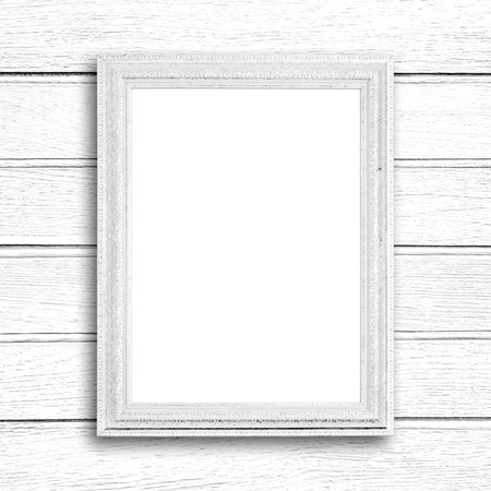 white wood: White picture frame on white wood wall. Stock Photo