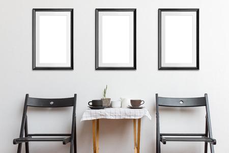 Mock up poster frame in coffee corner interior background. Archivio Fotografico