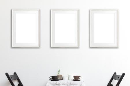 Three mock up poster frame in coffee corner interior background. Standard-Bild
