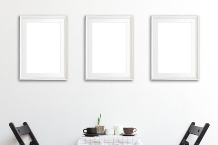 Three mock up poster frame in coffee corner interior background. Stock Photo