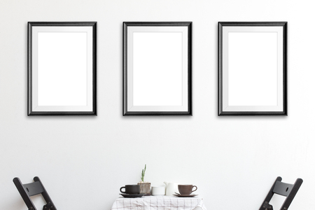 Three mock up poster frame in coffee corner interior background. Imagens