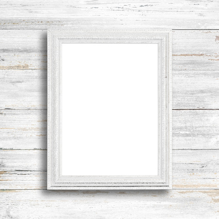 distressed: White picture frame on white wood wall. Stock Photo
