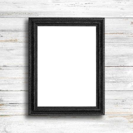Zwarte omlijsting op een witte houten muur. Stockfoto