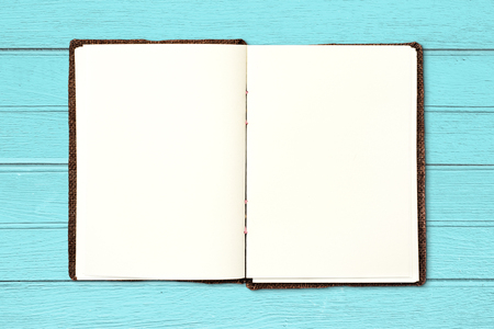 book open: Open blank book on vintage blue wood background. Stock Photo