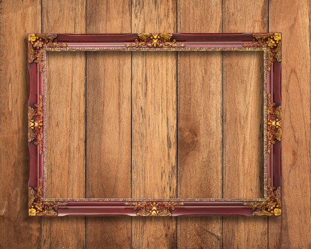 frame on wall: Old picture frame on vintage wood wall. Stock Photo